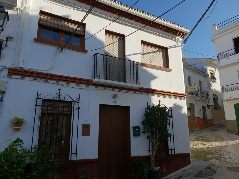 Large corner townhouse in the heart of Guaro village.  Enter the house into a cozy living room and d, Spain