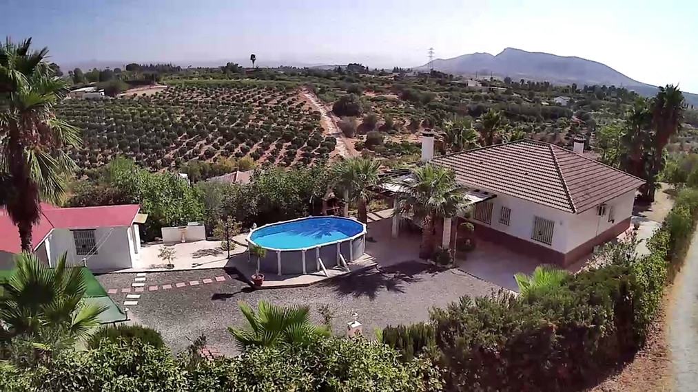 Finca set in a picturesque location with separate accommodation.   The main house comprises entrance, Spain