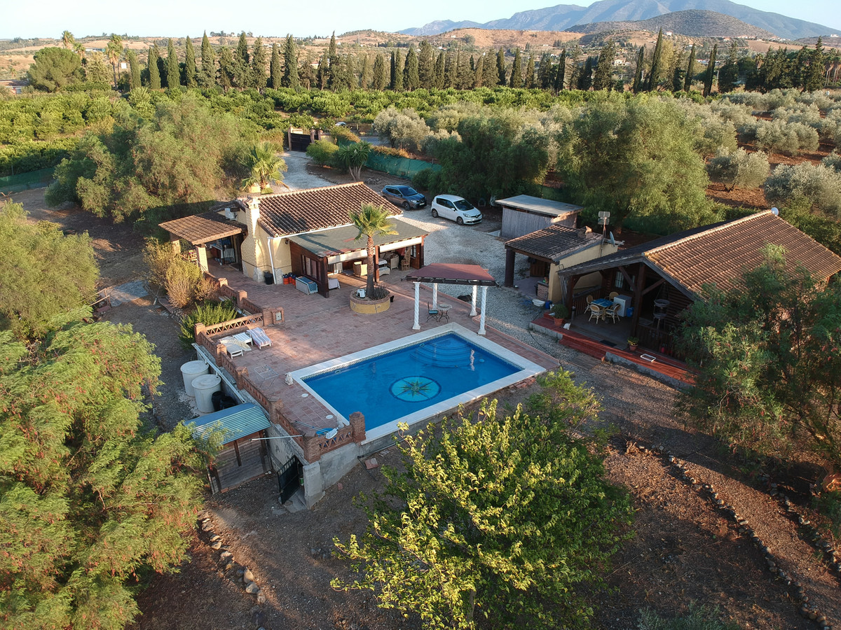 2 houses on a private plot with beautiful views.  Electric gates open up to the driveway with ample , Spain