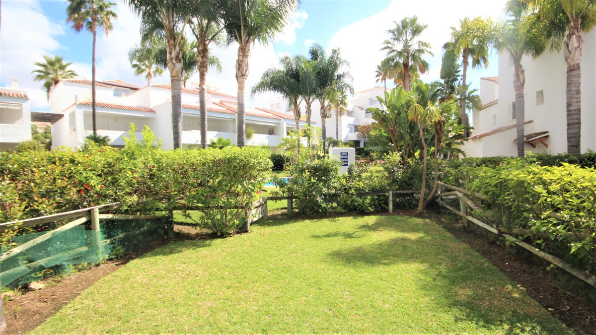 Beautiful Townhouse set in beachfront urbanization in bahia de marbella. Gated complex with direct a,Spain