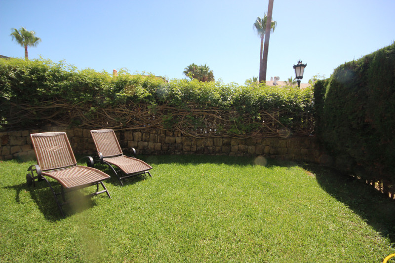 Large groundfloor apartment with large private garden, with sea views. Set in very much sought after,Spain