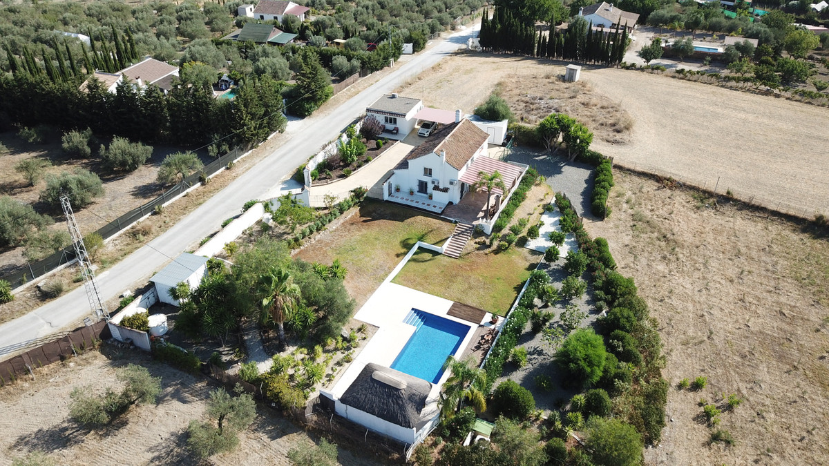 Exquisite country house with separate guest studio, incredible views and stunning pool area in Coin.,Spain