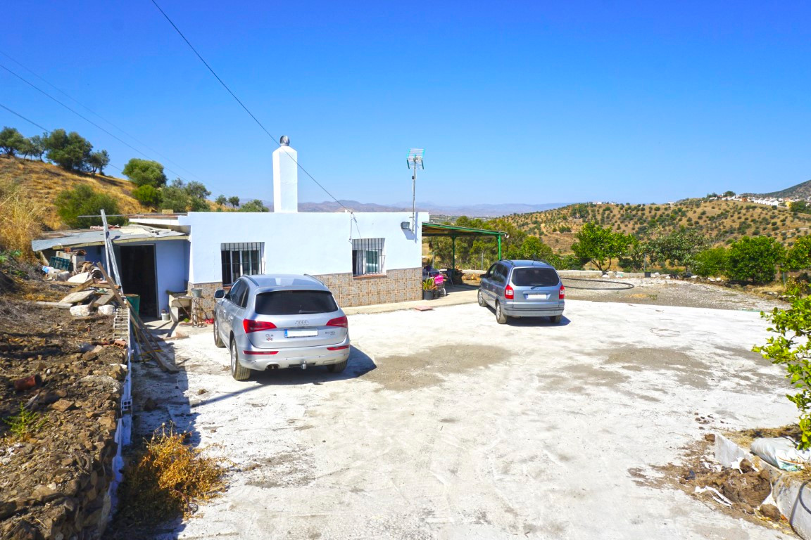South facing country house offering fabulous mountain views.  The plot is terraced and has olive tre,Spain