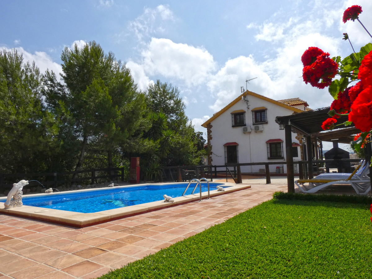 Beautiful country property with incredible views in Almogia. The house has a build size of around 25,Spain