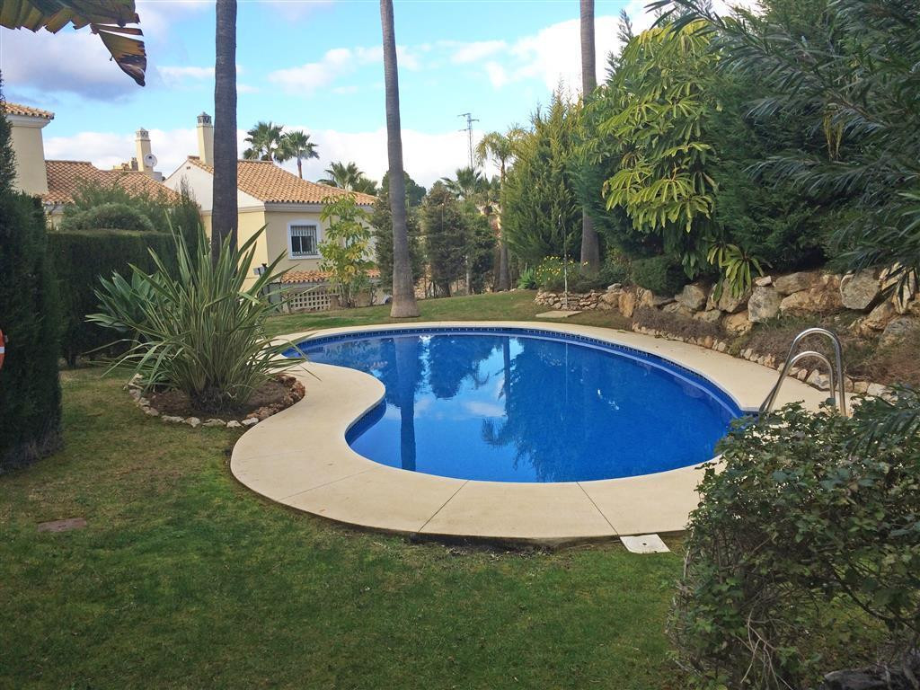 Situated on the much sought after Alhaurin Golf resort, this spacious townhouse offers a private cov,Spain