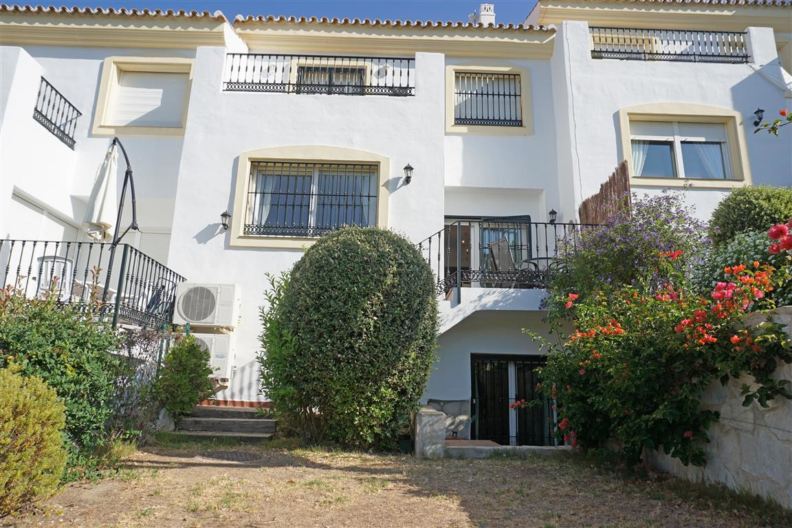 A fantastic, spacious, south facing, front line golf townhouse with private garden overlooking the 9,Spain
