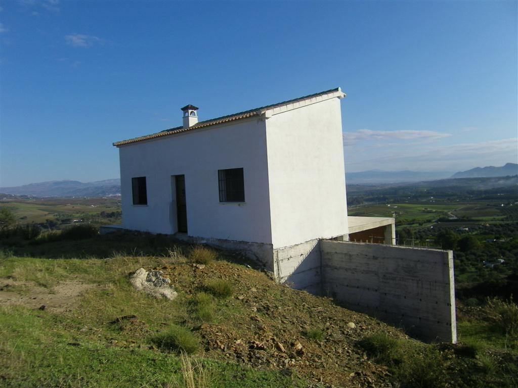 Plot of rustic land with an unfinished building, situated on the outskirts of Coin with spectacular , Spain