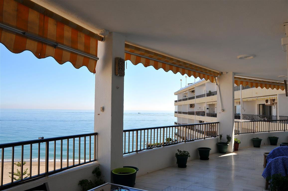 Fantastic large frontline beach apartment (2 apartments joined together) on the 2nd floor, with priv,Spain