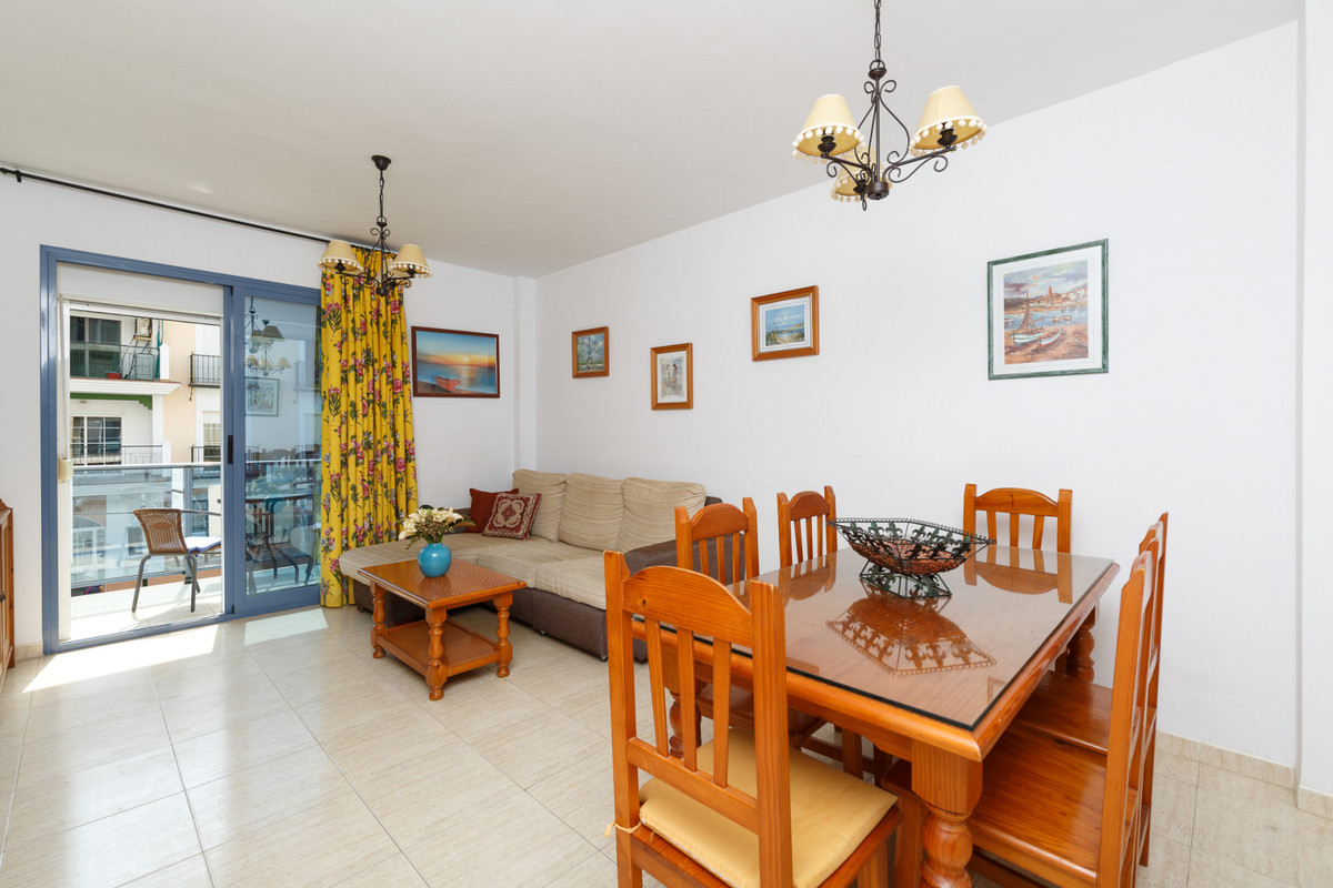 This spacious two bedroom apartment is located in the Center of El Morche and only 100m from the bea, Spain
