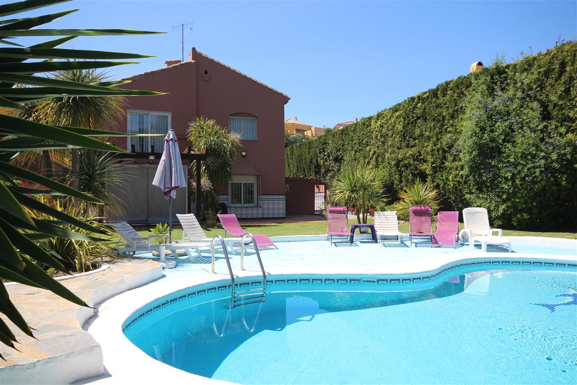 GUADALMINA ALTA. A great villa set on a double plot on the 16th hole of Guadalmina Golf Club. This v,Spain