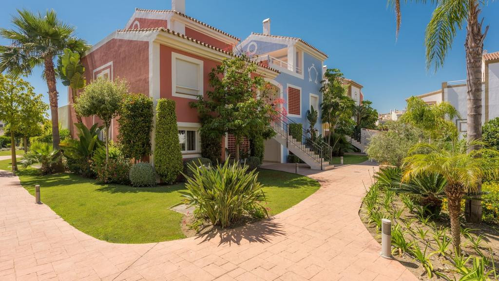 This townhouse is located in a luxurious residential resort area consisting of apartments, duplex pe, Spain