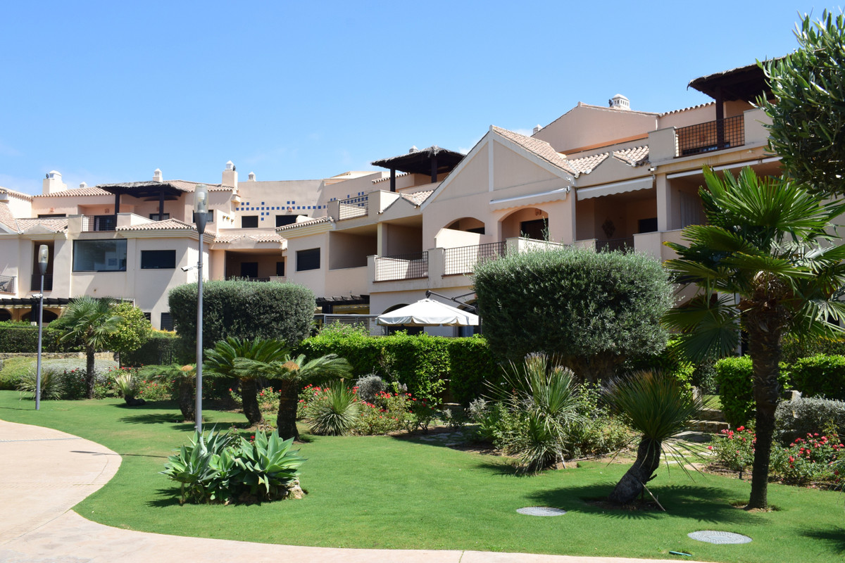 This cozy elevated ground floor apartment with two spacious bedrooms with private garden and access ,Spain