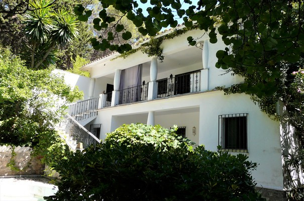This characteristic villa is located in the hills of Marbella, surrounded by the forests of Montua w,Spain