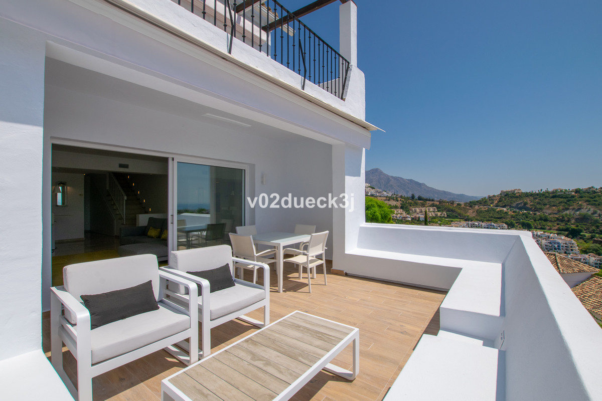 A modern townhouse with an open plan design and lovely terraces with stunning views of the golf cour, Spain