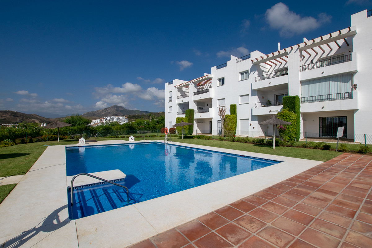 A stylish apartment with two bedrooms and nice views of the pool, mountains and sea in a popular and,Spain