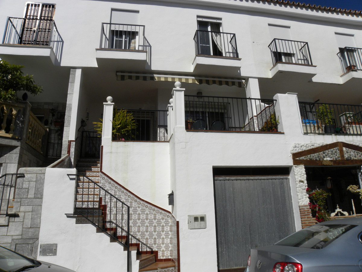 This beautiful townhouse is in a quiet urbanisation 10 minutes walk from Mijas village set among the, Spain