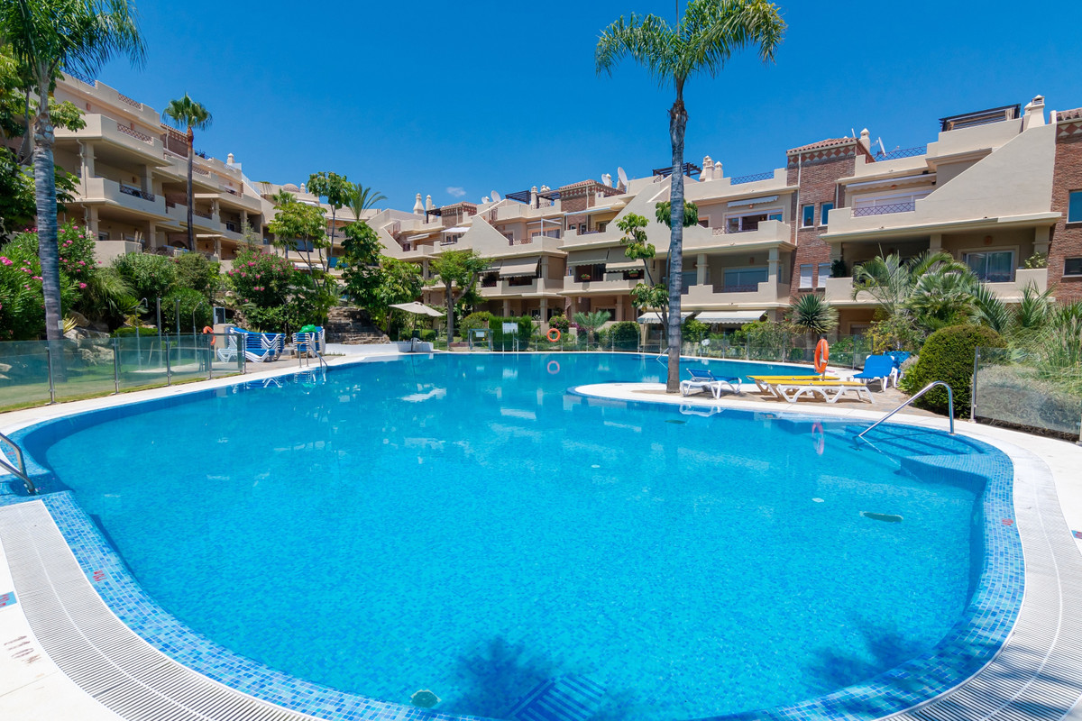 Nice south faced family apartment in a small gated complex, with hugh pool and tropical gardens. Sit,Spain