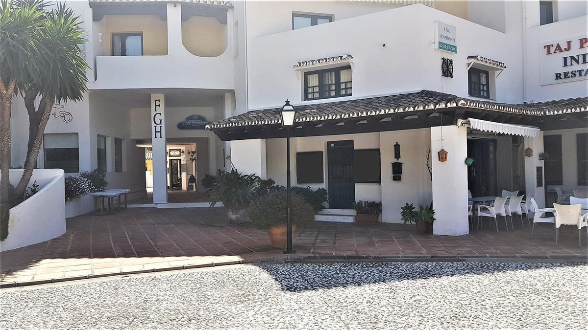 INVESTMENT OPPORTUNITY - Commercial office with a studio apartment upstairs. The property is situate,Spain
