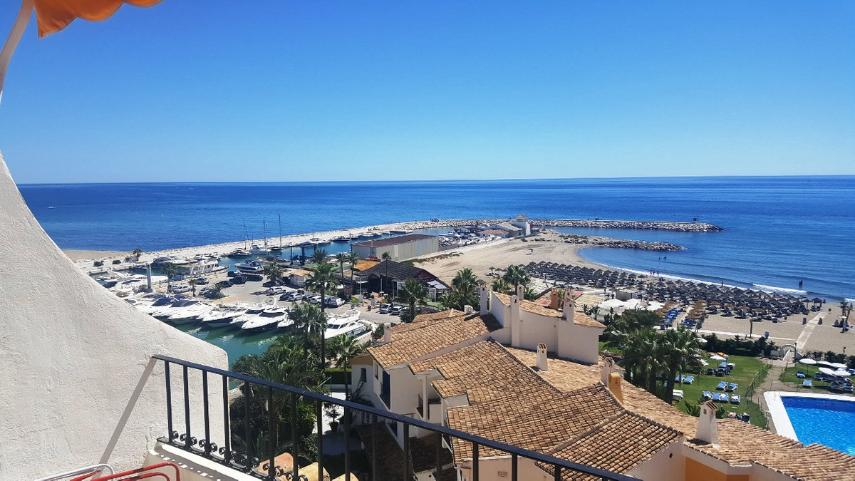 REDUCED FROM €365,000. Fourth floor apartment with panoramic views, Puerto de Cabopino, Marbella, Co, Spain
