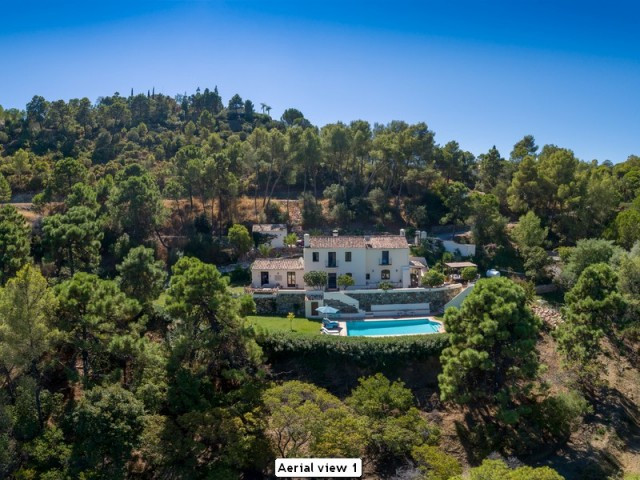 This idyllic country house is located within the exclusive gated estate of El Madronal, with breath- Spain