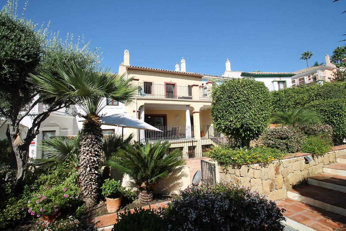 WITHIN WALKING DISTANCE TO THE BEACH AND ALL AMENITIES • SEA VIEWS • East-facing townhouse situated ,Spain