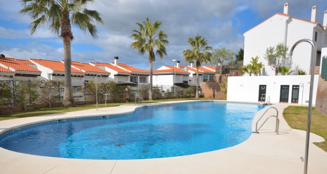 Modern comfortable townhouse with large terrace and spacious living area located in a gated complex , Spain