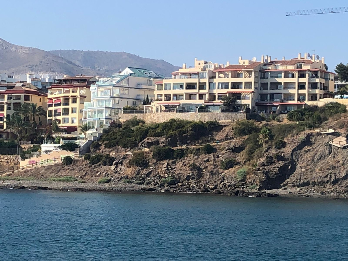 Beach-front apartment for sale in Torrequebrada, Benalmadena. The property features a living/dining ,Spain