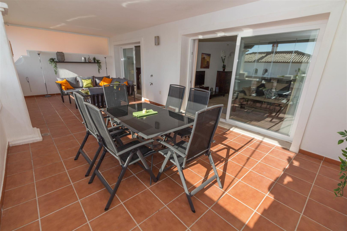 Enjoy the wonderful views from the large glazed terrace of this modern  2 bed, 2 bath apartment.  Th,Spain