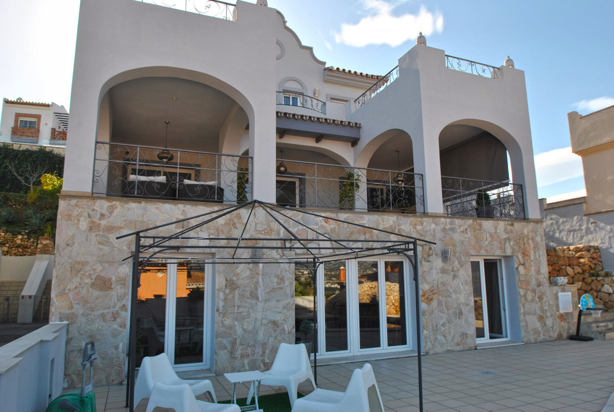 A stunning villa located in an exclusive development in Mijas Costa with panoramic sea and mountain Spain