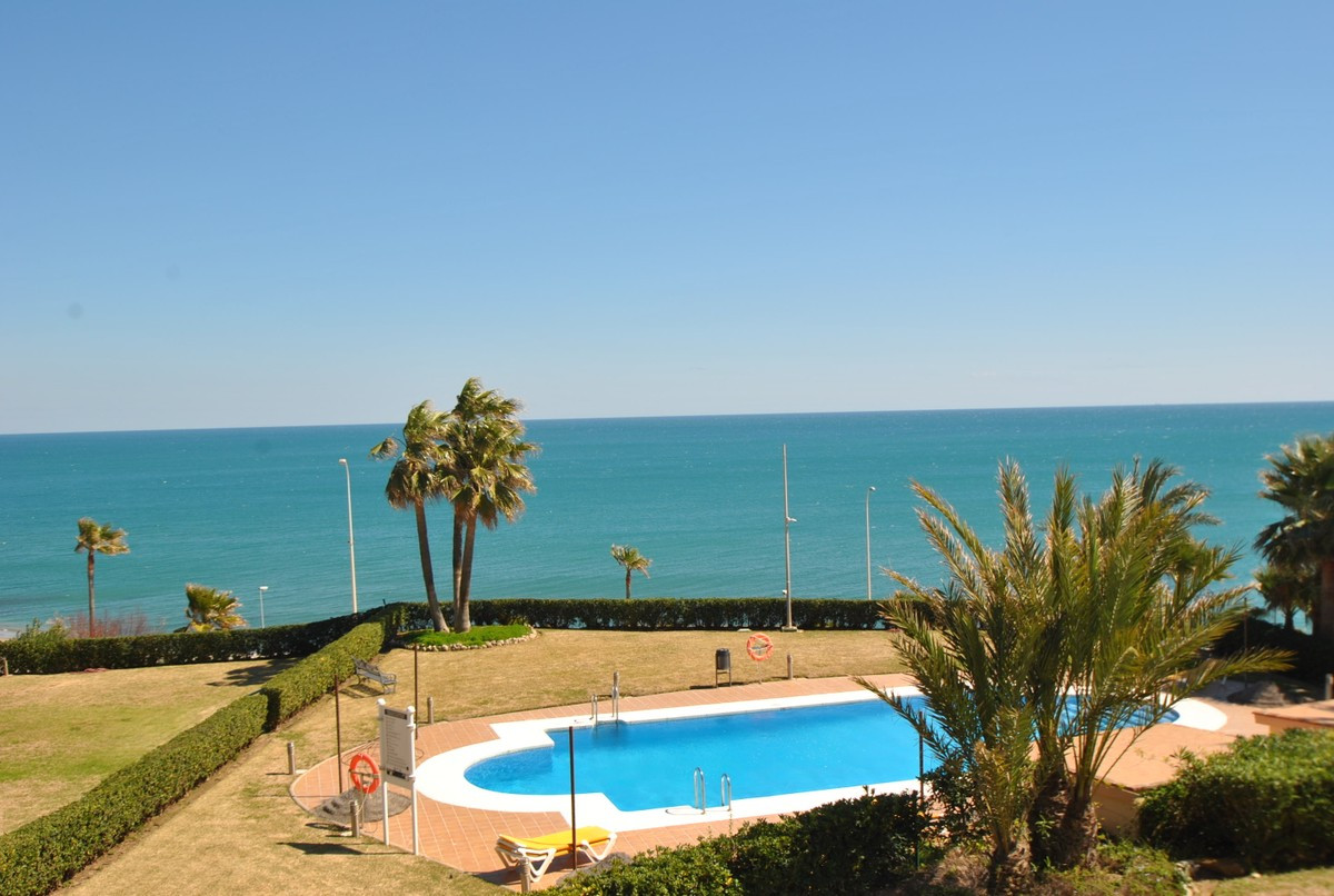 A stunning two bedroom apartment in an unbeatable location, just 100 meters to the beach in Mijas Co, Spain