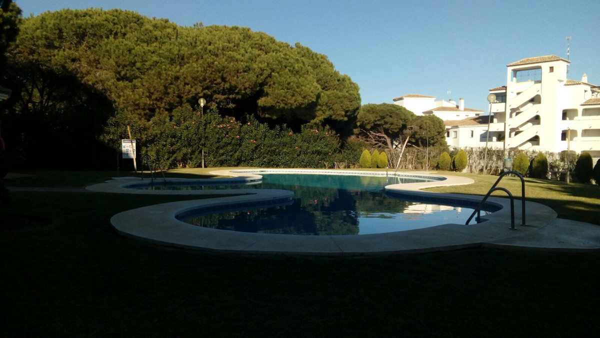 A large 3 bedroom corner apartment in a small development in an ideal location in lower Calahonda, j, Spain