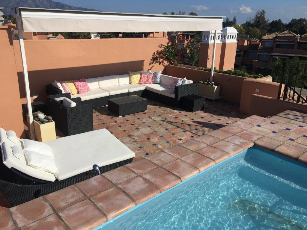 Amazing beachside duplex penthouse with rooftop terrace and private pool located in the exclusive co,Spain