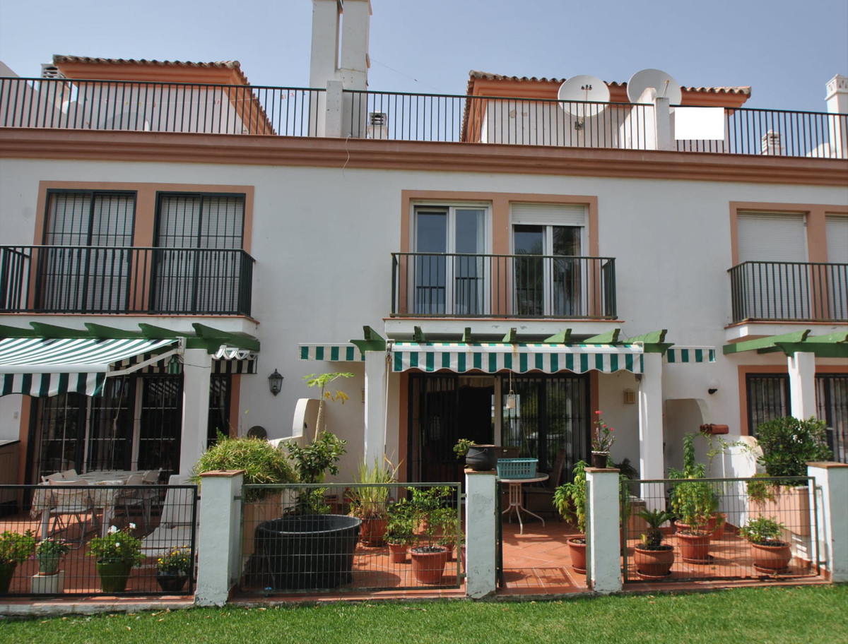 A large three bedroom townhouse located in a popular gated complex within easy walking distance of P,Spain