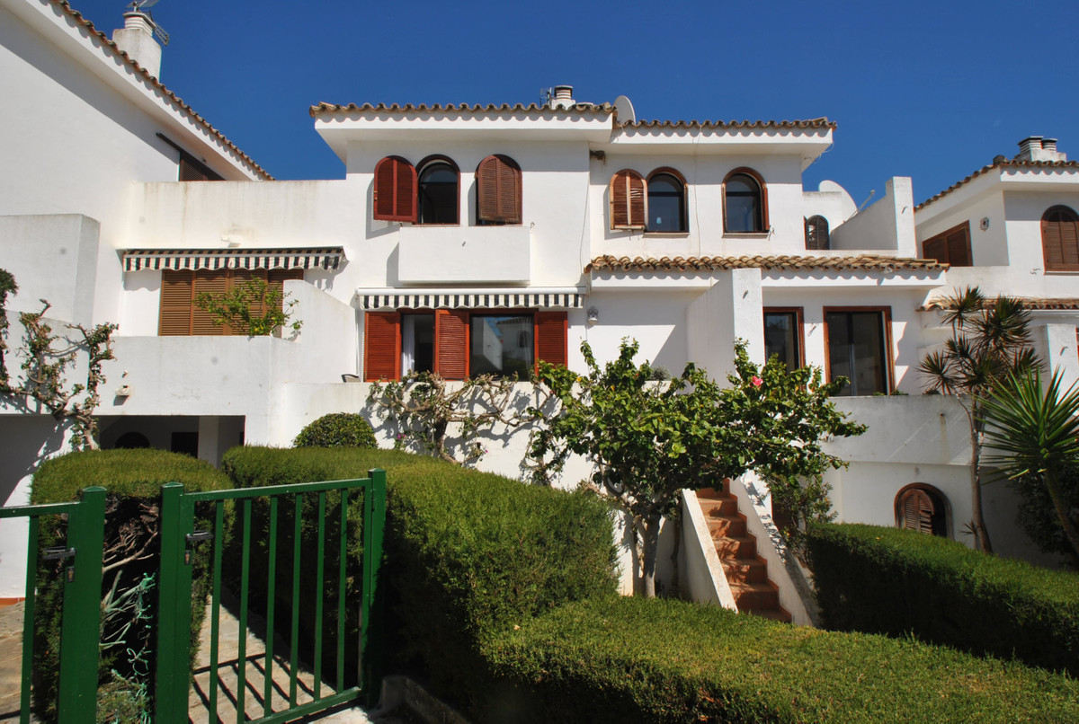 A wonderful four bedroom townhouse located beachside. in the Cancelada area of Estepona.  The proper,Spain