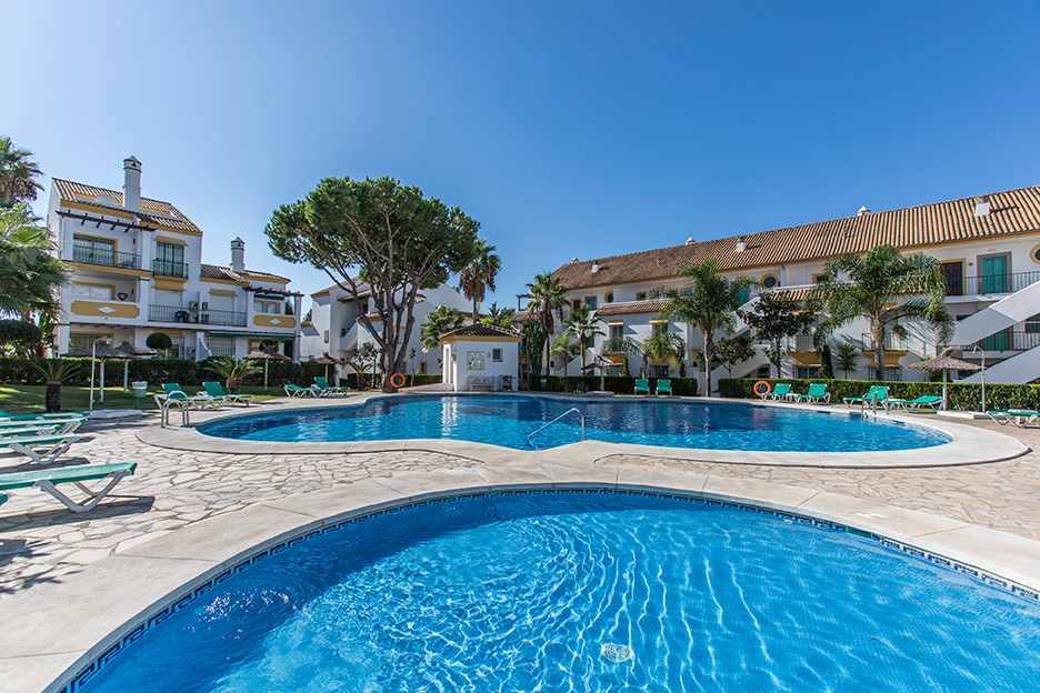 This sunny ground floor apartment features two bedrooms, two bathrooms, an open plan kitchen and a s, Spain