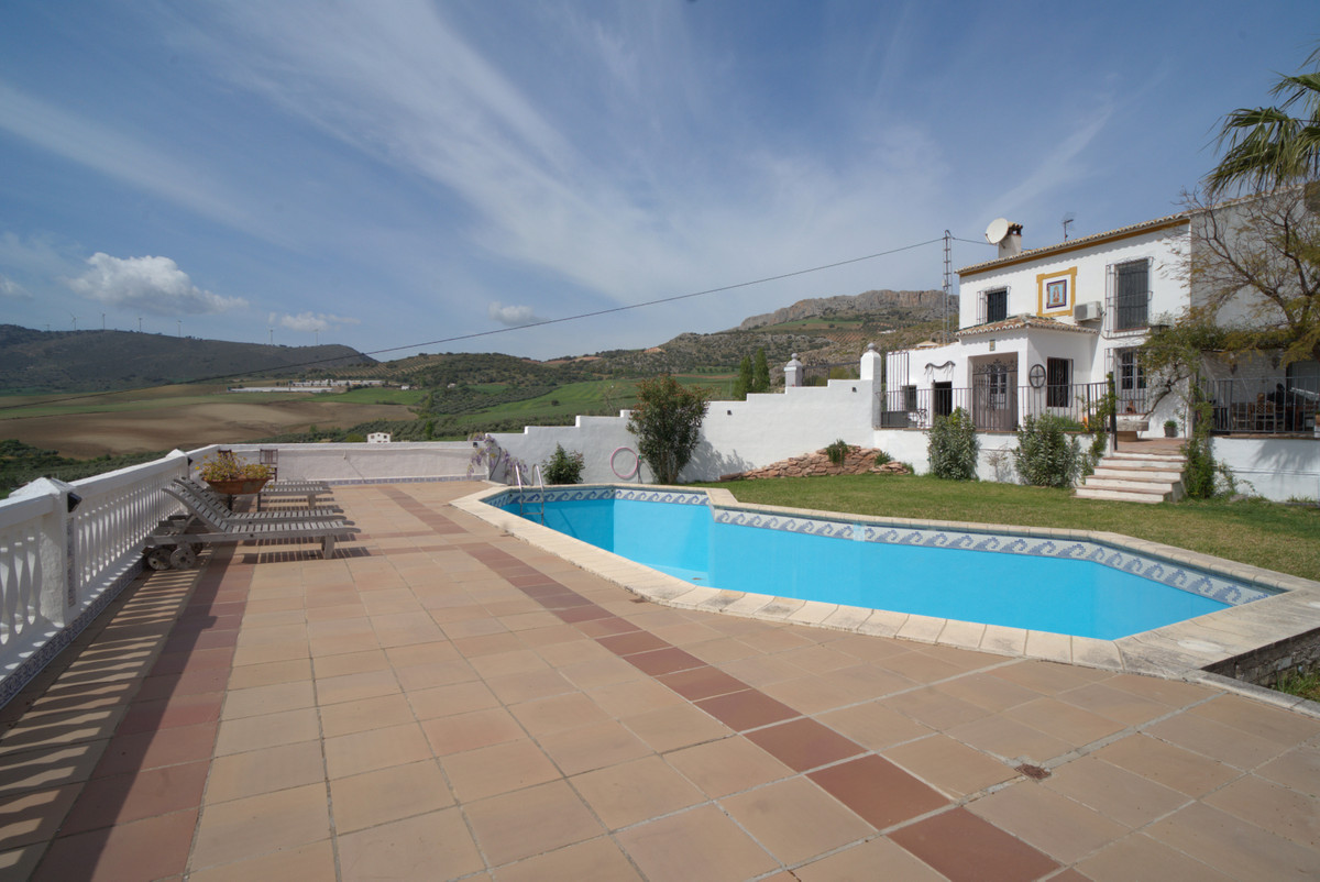 This pretty property located in Canete La Real has 3 bedrooms and  2 bathrooms, 2 kitchens and a lar, Spain