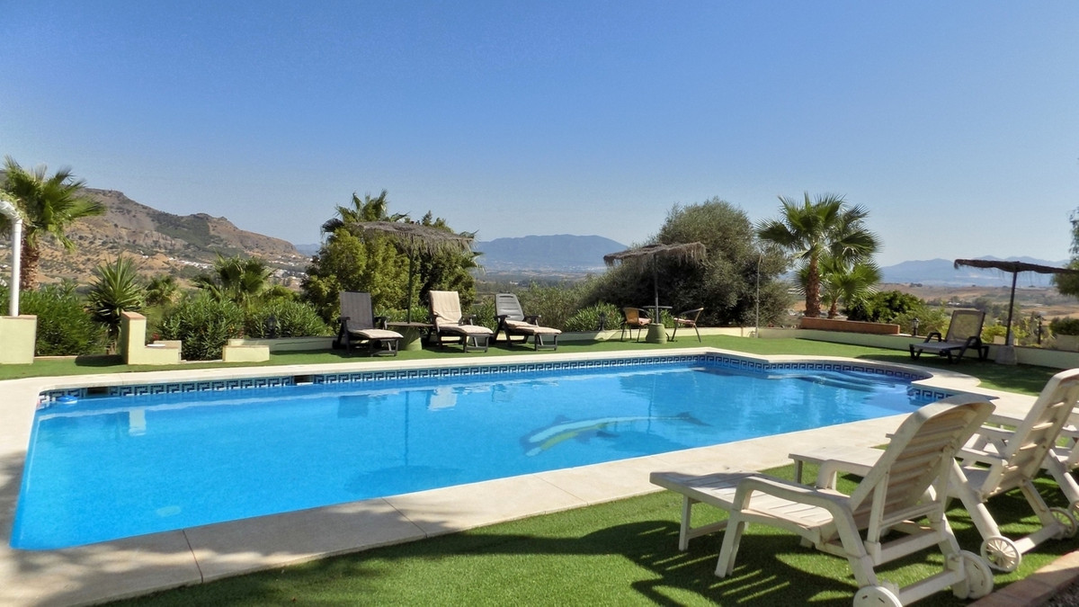 Located on the outskirts of Pizarra only a short distance from the main road but in an elevated posi,Spain