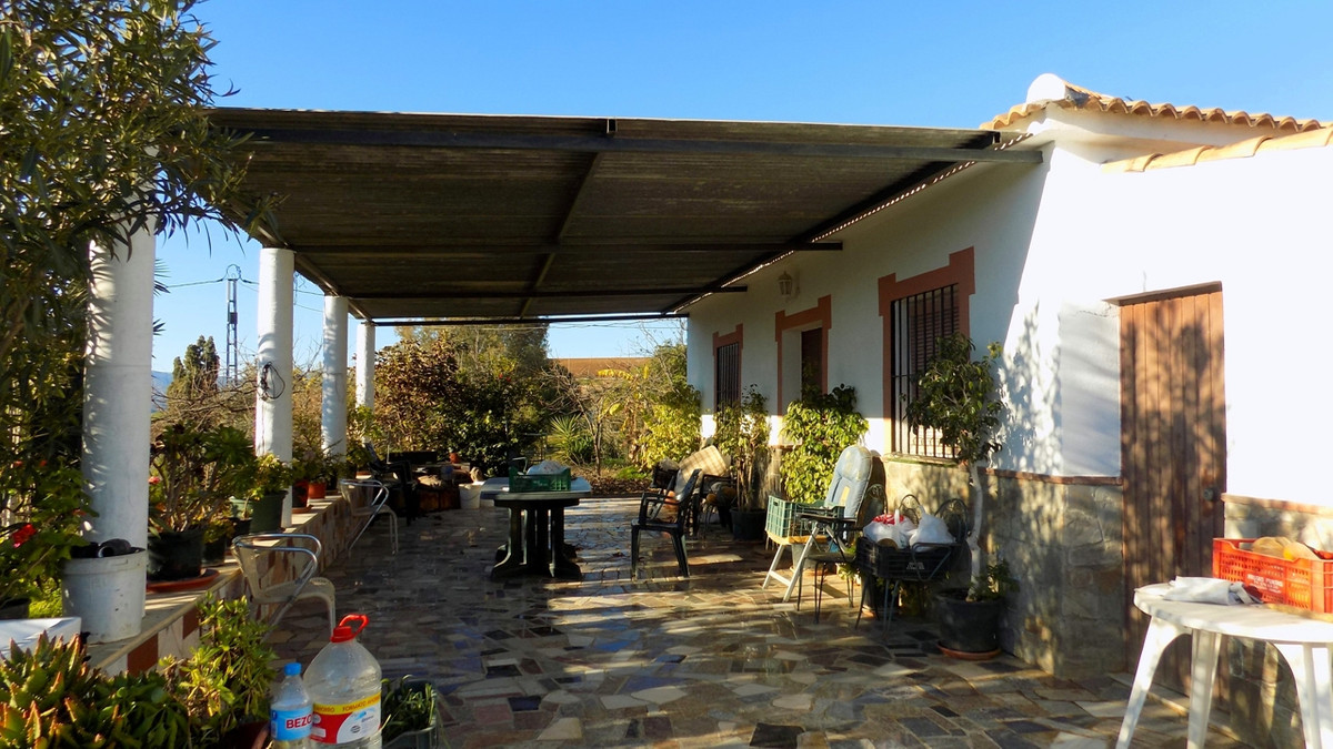 This cute cottage is located in the area known as Viuda Chica in Coin; the Rio Grande River can be s, Spain