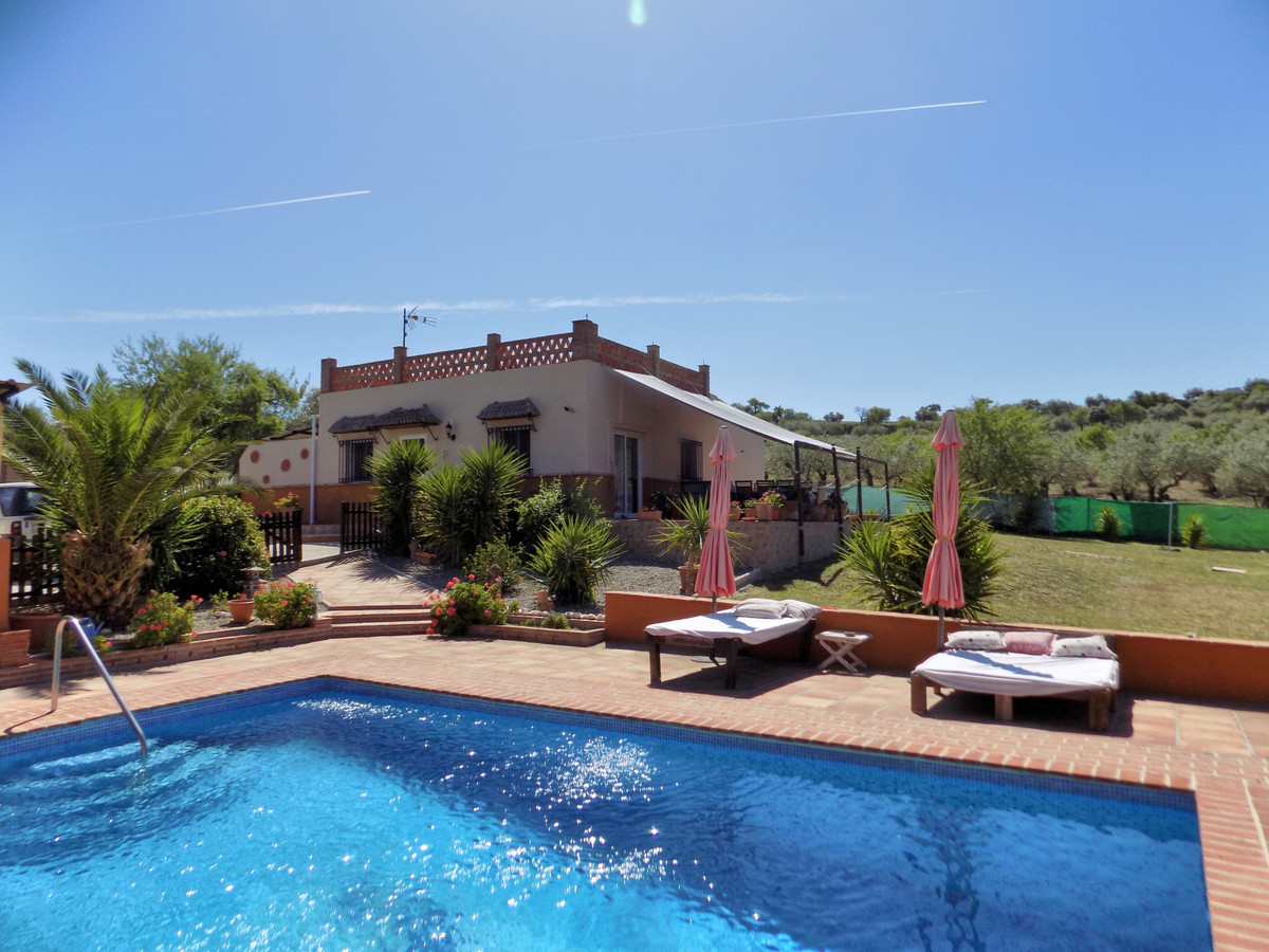 This beautiful full fenced property is located on the outskirts of the white washed village of Monda,Spain