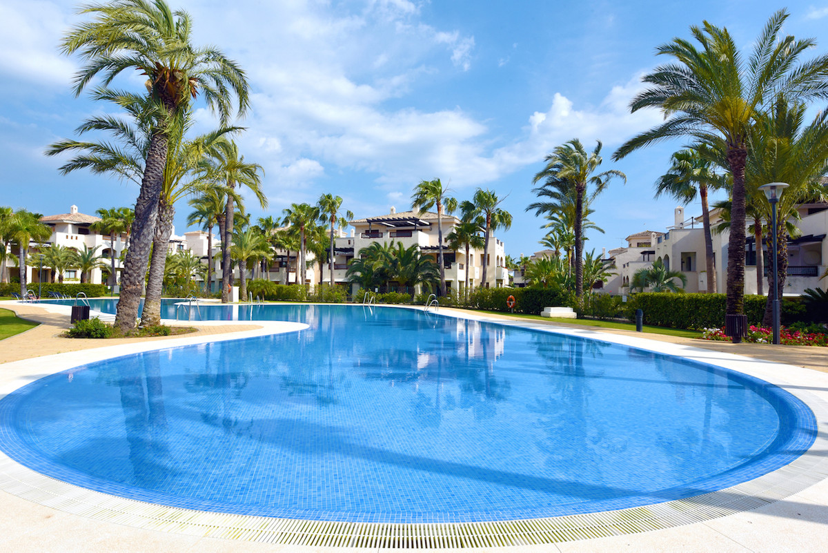 Excellent first floor luxury apartment with views overlooking a fabulous swimming pool in this well ,Spain