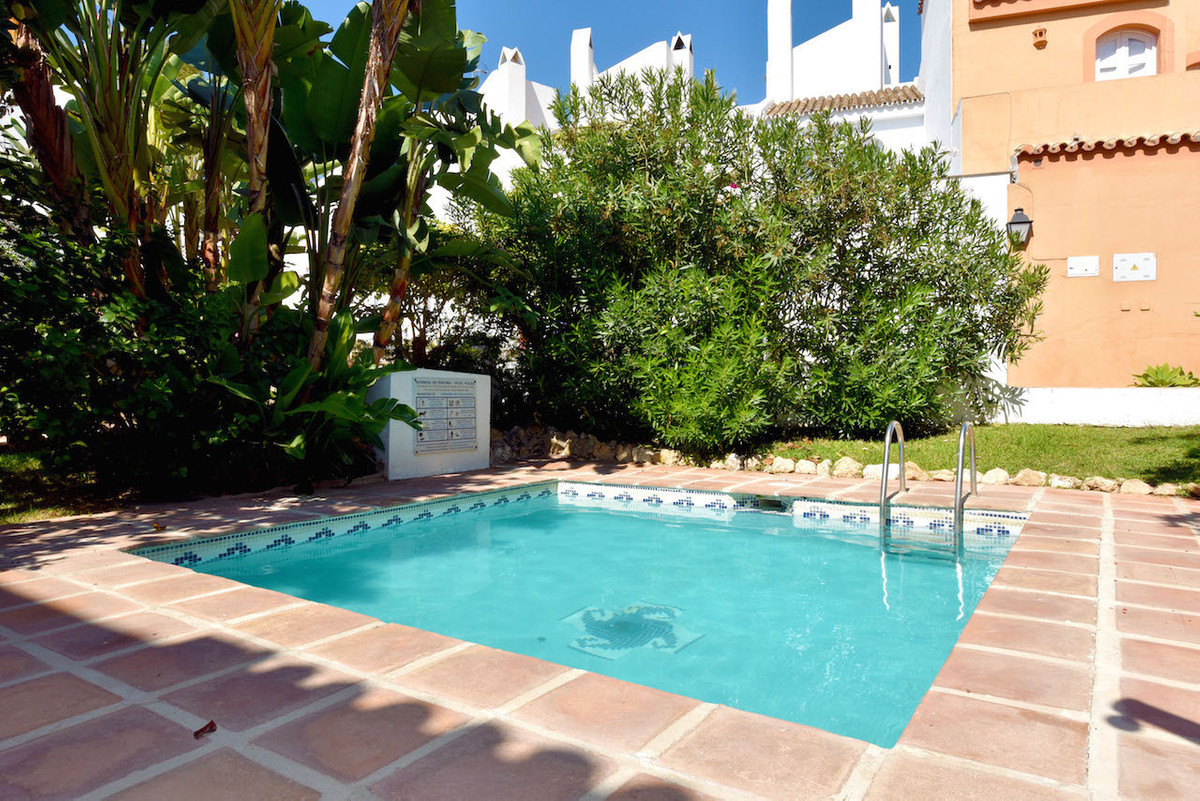 A lovely Spanish style three bedroom townhouse in a gated complex walking distance to Puerto Banus a,Spain