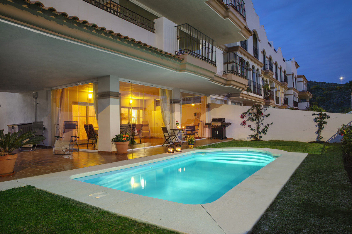 Immaculate corner ground floor apartment with ample outdoor space and private pool in the upmarket u,Spain