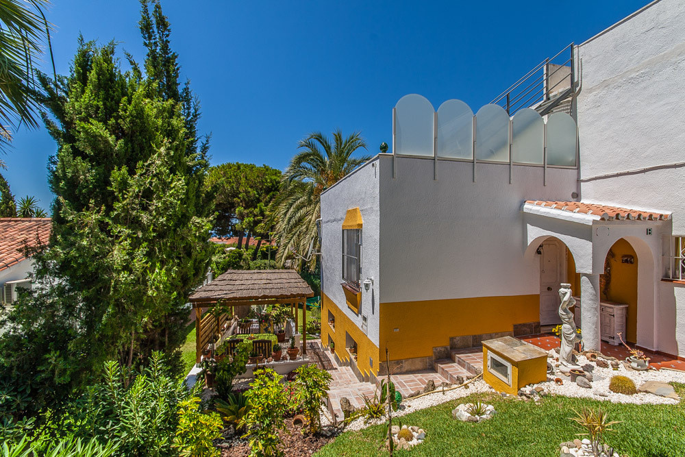 Lovely townhouse with beautiful views over El Faro to the sea. The property is divided into two sepa, Spain