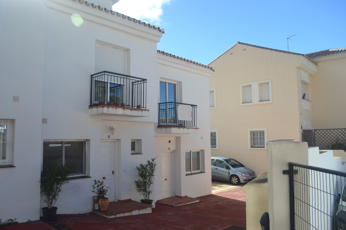 This nice little townhouse is one of tree in a row.  It is the outside one and has a little garden. ,Spain