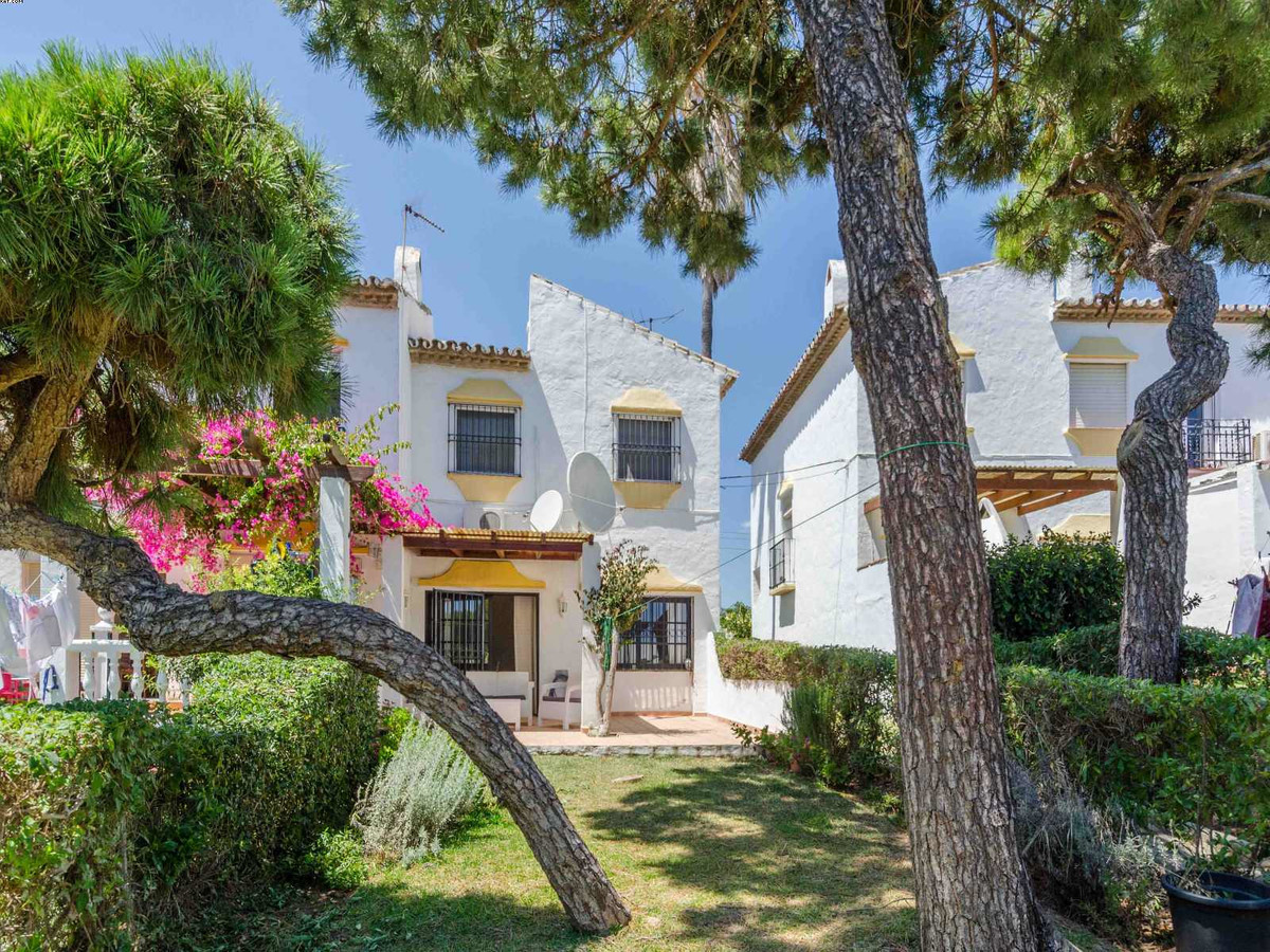 A very nice townhouse situated in a private area of El Chaparral, consisting of 3 bedrooms on the up, Spain