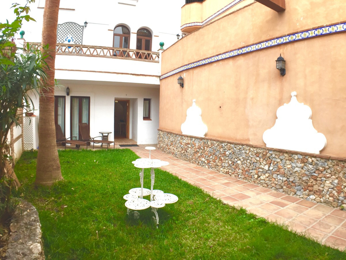 This large ground floor apartment in Frigiliana is located in the popular La Fuente complex, with be,Spain