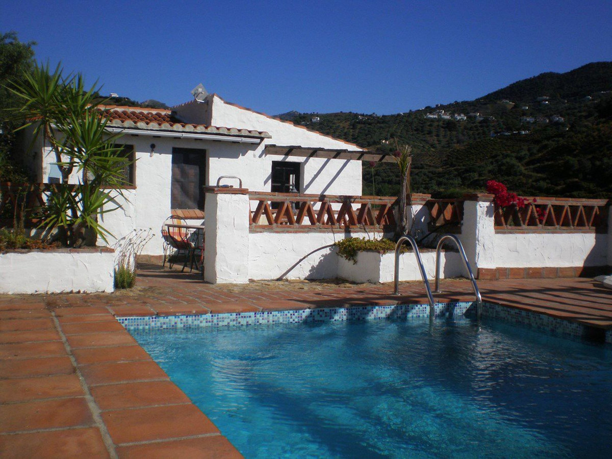 Detached Villa in Frigiliana, with two bedrooms and two bathrooms. There is a lounge with fireplace , Spain