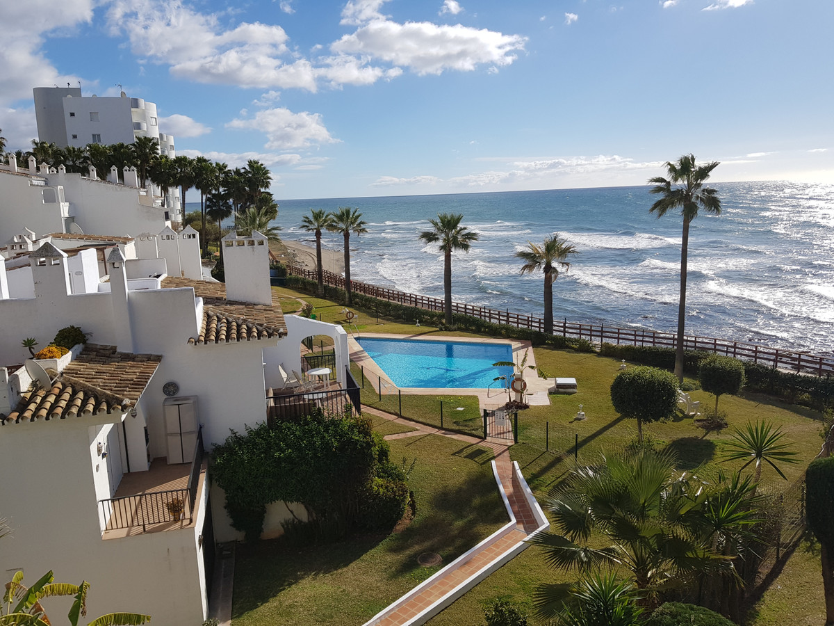 Frontline beach apartment offering two bedrooms, two bathroms, a large living room with access to a , Spain