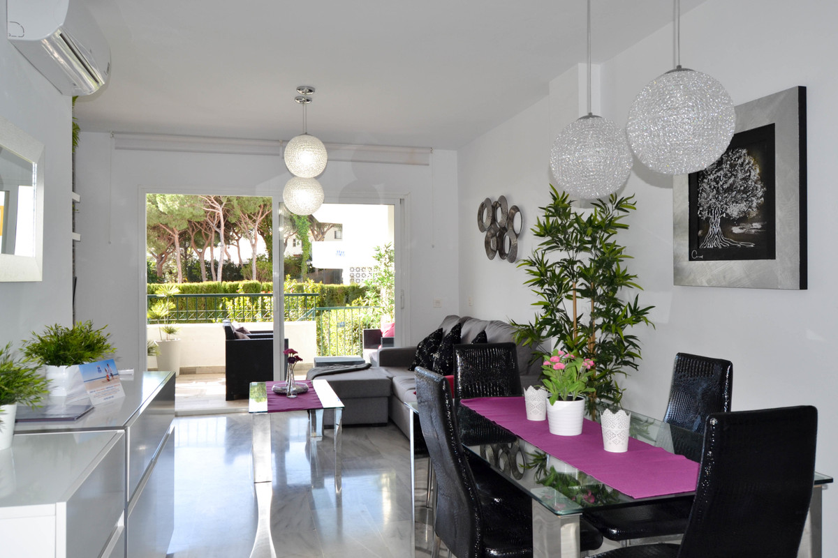 Apartment with sunny terrace and garden, walking distance to the sea. This lovely apartment with bot, Spain
