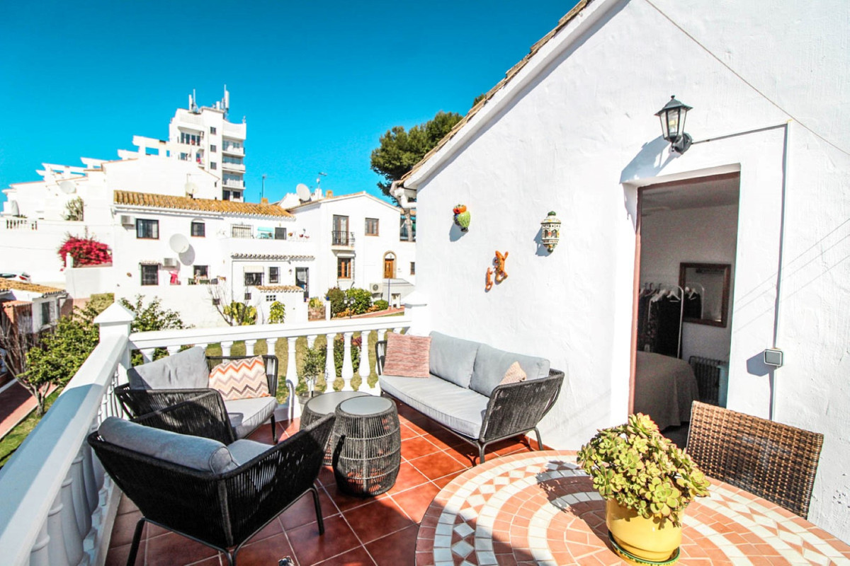 perfect location! This unique townhouse is located in quiet charming Spanish style urbanization just, Spain